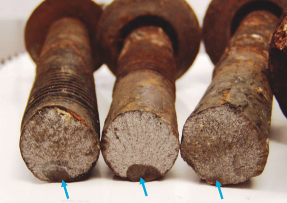 FIGURE 3 Environmental cracking of rock bolts. The arrows show the initial subcritical crack.