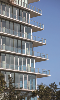 The condominium complex includes hurricane-resistant window walls, glass doors, and metal framing systems finished with fluoropolymer coatings. Photo courtesy of PPG.