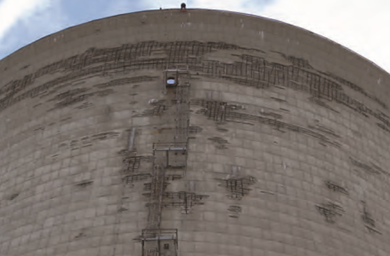"Concrete deterioration at upper section of the cooling tower for Unit #3 in 2010, including removed concrete from ""de-spalling"" efforts."