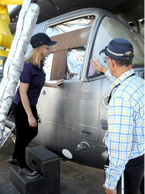Jessica Templeton, left, a NAVAIR materials engineer at FRCE, and David Stricklin of Compass Systems inspect the finished product following the first-ever U.S. trials of a new cold spray technology application. Photo by Heather Wilburn, FRCE.